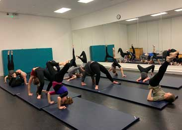 Our Acro class working on flexibility