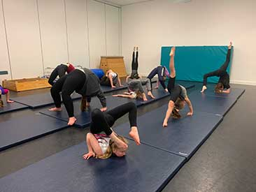Dance Expression Acro class working hard in the studio