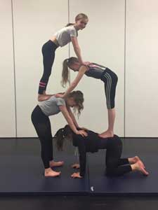 Our Acro class working hard on a balance pose