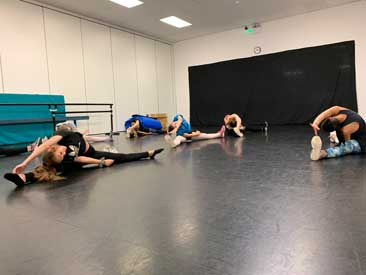 Our senior jazz class warm up for their class with Miss Emily
