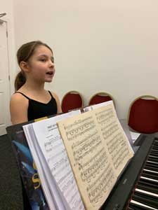 Singer rehearsing at piano