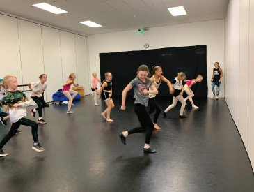 Our junior jazz class practice their latest routine in the DE studios