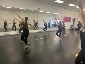 Senior contemporary dancers rehearsing in front of the mirror